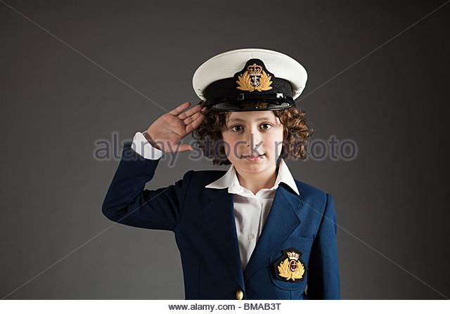 young-boy-dressed-up-in-sailor-outfit-saluting-bmab3t